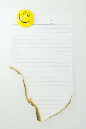Note with a smiling magnet Stock Photo