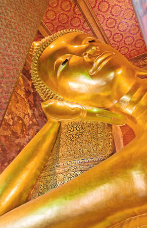 Giant lying buddha statue in wat pho temple, bagnkok, thailand photo