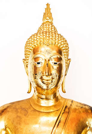 Golden buddha head isolated over a white background.