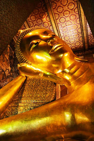 Reclining Buddha statue in Thailand Buddha Temple Wat Pho , Asian style Buddha Art Stock Photo