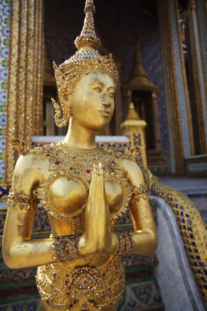 kinaree, a mythology figure, is watching the temple in the Grand Palace Bangkok Thailand photo
