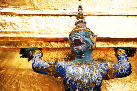 Golden statue at Grand Palace Wat Phra Kaeo Bangkok Thailand Stock Photo