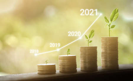 Growth in 2021 year concept. Business graph with arrow up. Growing money coins stack.