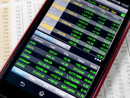 touchscreen smartphone with stock market application Stock Photo