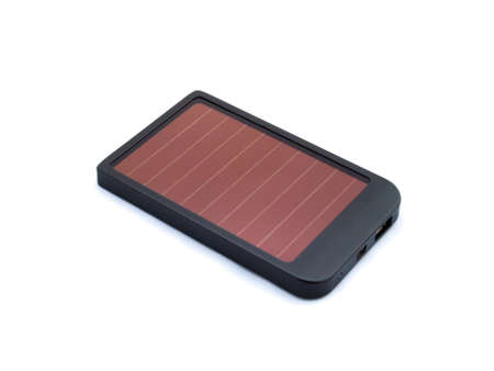 Solar charger for mobile phones isolated photo