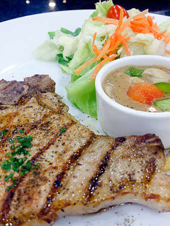 Grilled pork steak with salad Stock Photo