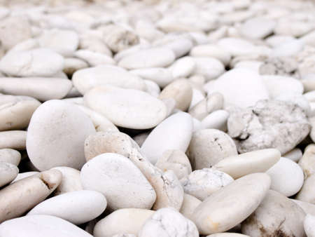 sea stone naturally polished white rock pebbles background