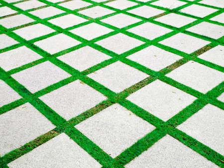 textuur van stenen blok met gras achtergrond Stockfoto