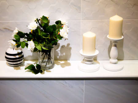 modern bathroom decoration with candle and rose flower photo