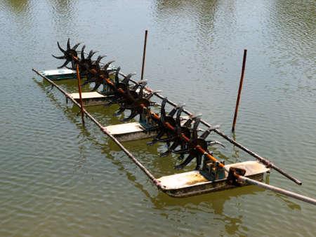 paddle wheel: shrimp farm with paddle wheel aerator Stock Photo