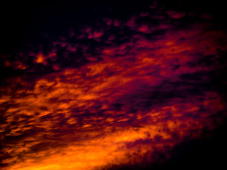 Abstract background dramatic sky in moody flame