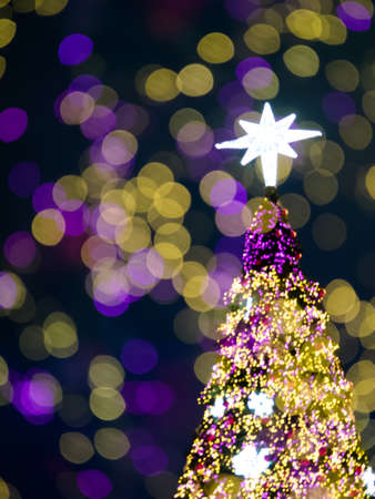Abstract double exposure christmas tree bokeh with blurred lights Stock Photo
