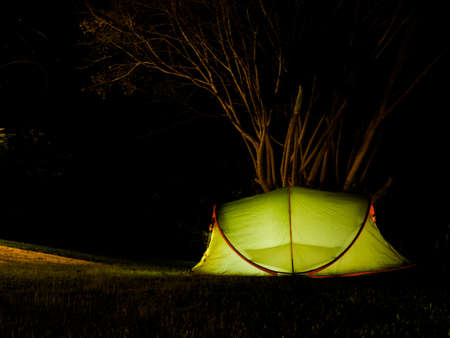 Outdoor camping tent adventure under a night sky Stock Photo