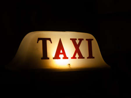 Taxi sign at night background