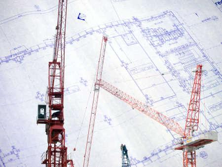 Contruction crane with blue print background Stock Photo