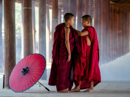 BAGAN, MYANMAR - APR 08, 2018: Two buddhist monk dressing