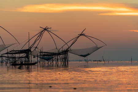 Large fish traps used for fishing with Southern Thai fishery on sunset Stock fotó