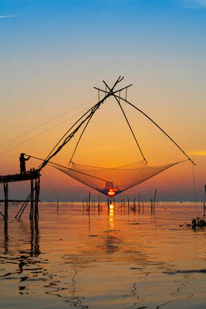 Large fish traps used for fishing with sourthern Thai fishery on sunset Stock fotó