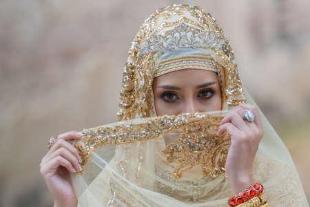 Portrait muslim bride posing in yellow dressing