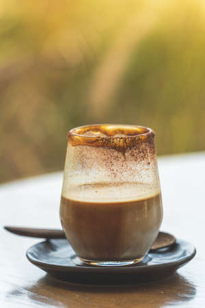close up cup of coffee on wooden table Stock fotó