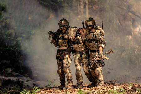 team of soldiers engaged in operation rescue Stock Photo