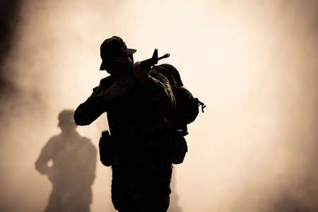 silhouette action soldiers walking hold weapons in jungle Reklamní fotografie