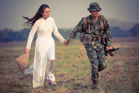Love of soldier and a vietnamese woman Stock Photo