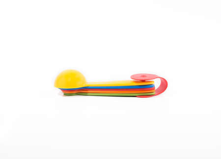 measuring spoon: colorful plastic measuring spoon isolated