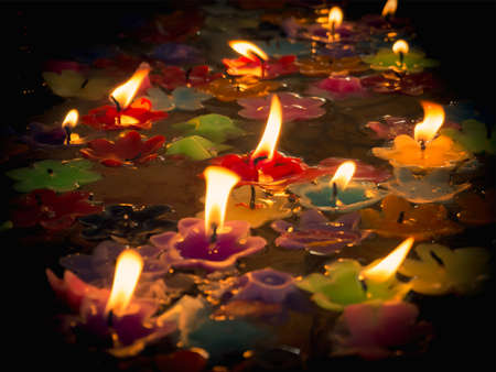 burning time: beautiful Candles on water, pray to the Buddha