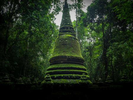 namtok: old green stupa in nature located at Namtok Phlio National Park, Chanthaburi, THAILAND Stock Photo