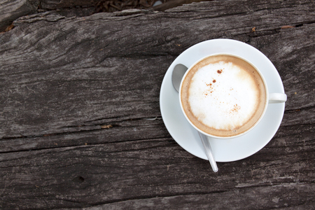 capuchino: Coffee cup on old wooden table Stock Photo