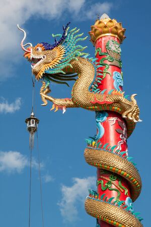 festival scales: Chinese style dragon statue with blue sky in temple Stock Photo