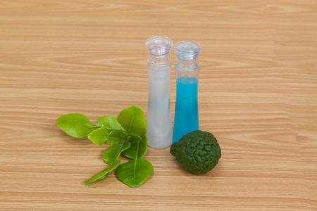 relaxant: bottles of bergamot essential oil on wooden table