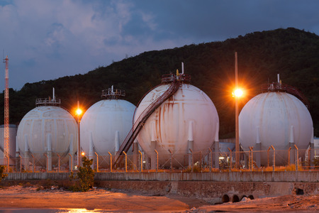 storage tank: Natural gas storage tank in sphere shape at twilight time Stock Photo