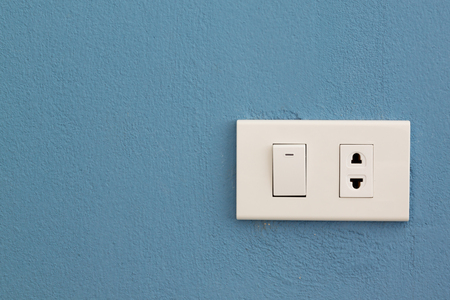 switch plug: Electricity switch and plug on concrete wall
