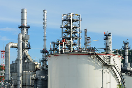 fuel storage: View of oil refinery plant and fuel storage tank with blue sky on a sunny day Stock Photo