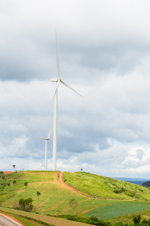 Wind turbine on green mountain Stock Photo