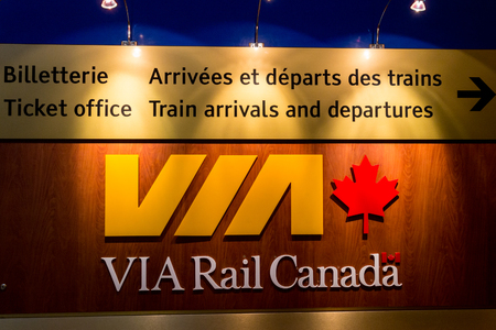 bilingual: Via Rail Canada departures board in Quebec City Royal Palace rail station. Via Rail Canada is the hand rail passenger carrier in Canada. Editorial