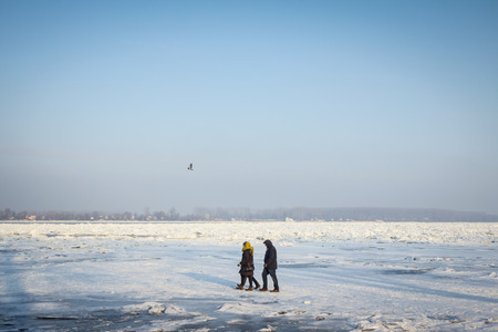 belgrade: BELGRADE, SERBIA - JANUARY 21, 2016: People walking on to the frozen Danube, due to year exceptionnaly cold weather over the Balkans lasting for more than 10 days