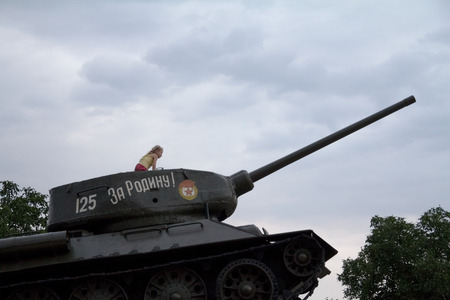 breakaway: TIRASPOL, TRANSNITRIA (MOLDOVA) - AUGUST 12, 2016: Little Girl playing on the Tank Monument erected to commemorate the 1992 Transnitria civil war  Transnistria (also called Trans-Dniestr or Transdniestria) is a small breakaway state located between Moldov