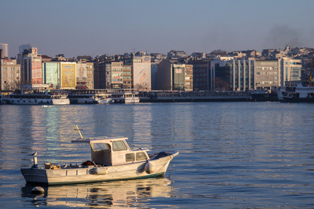 ISTANBUL, TURKEY - DECEMBER 27, 2015: Fishing boat on front of seafront Kadikoy, on the Asian side of the city
