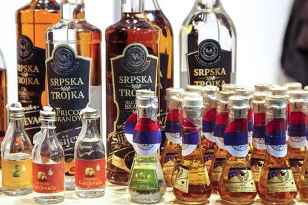rakia: BELGRADE, SERBIA - FEBRUARY 25, 2017: Various bottles of rakija, of different sizes and flavors, on display During the 2017 Belgrade tourism fair