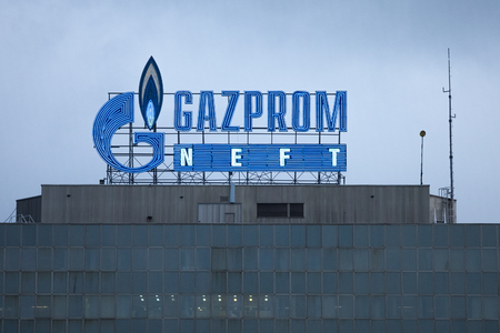 oligarchy: BELGRADE, SERBIA - APRIL 29, 2017: Logo of the Gazprom headquarters for Serbia. Gazprom is one of the main power and energy companies of Russia, with offices worldwide.