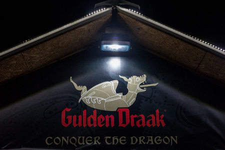 BELGRADE, SERBIA - AUGUST 19, 2017: Logo of Gulden Draak beer, taken on an Gulden Draak shop in Belgrade at night. Gulden Draak is one of the most known Belgian beers, sold worldwide  Picture of the logo of Gulden Draak taken in the streets of Belgrade, S