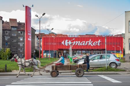 PETROSANI, ROMANIA - SEPTEMBER 23, 2017: Horse Cart - Carrefour Market Supermarket. Editorial