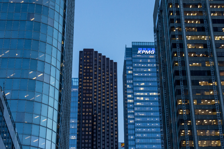 TORONTO, CANADA - DECEMBER 20, 2016: KPMG logo on their main office for Canada in Toronto, Ontario, at night, surronded by other Skyscrapers. KPMG is one of the main audit firms in the world, within the Big Four GroupPicture of KPMG logo on a skyscraper