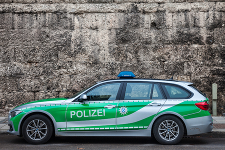 MUNICH, GERMANY - DECEMBER 18, 2017: BMW from the Bavarian State police (polizei) taken in Munich. The Bavarian State Police is in charge of law enforcement in the State of Bavaria.  Picture of a German police car from the Bavarian State police parked. Th