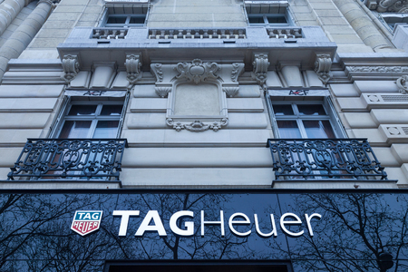 PARIS, FRANCE - DECEMBER 20, 2017: Tag Heuer logo on their main shop on Champs Elysees avenue. TAG Heuer is a Swiss luxury manufacturing company that designs, manufactures and markets watches and fashion accessories