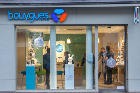 PARIS, FRANCE - DECEMBER 20, 2017: Bouygues Telecom logo on their main shop on Rue de Rivoli avenue. Bouygues Telecom is a French mobile phone, Internet service provider and IPTV company