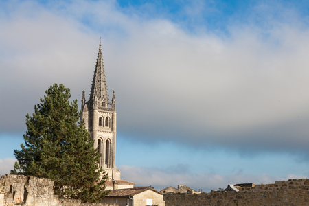 Collegial church of Saint Emilion, France, taken during a sunny afternoon by the medieval part of the village. Famous for its wine, the city and its religious complex